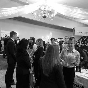Black and white photo of people at a booth for Lucas Horsfall