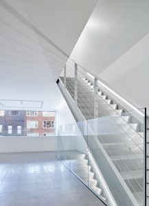 Staircase in white building