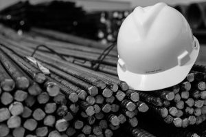 A hard hat on top of metal rods