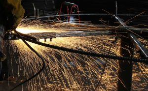 Sparks flying off of steel being cut