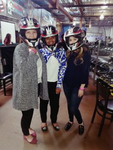 People posing in Go Kart helmets