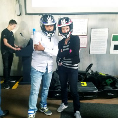 People posing by a Go Kart