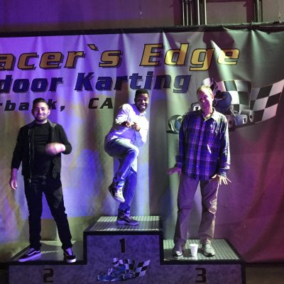 Go Karting winners standing on the podium.