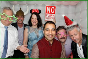 Holiday party photo booth of several employees