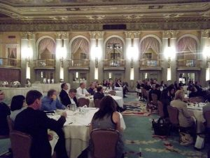 People sitting at a formal dinner.